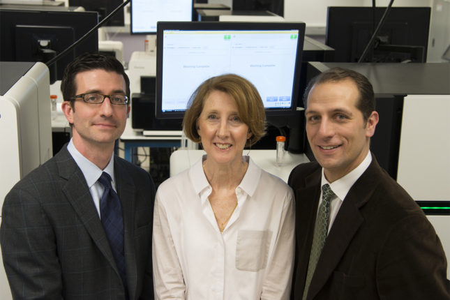 Robert J. Boston Photographs Cardiology left to right Nate Stitziel MD, Sharon Cresci MD and Phil Cuculich Shot with sequencing machines.